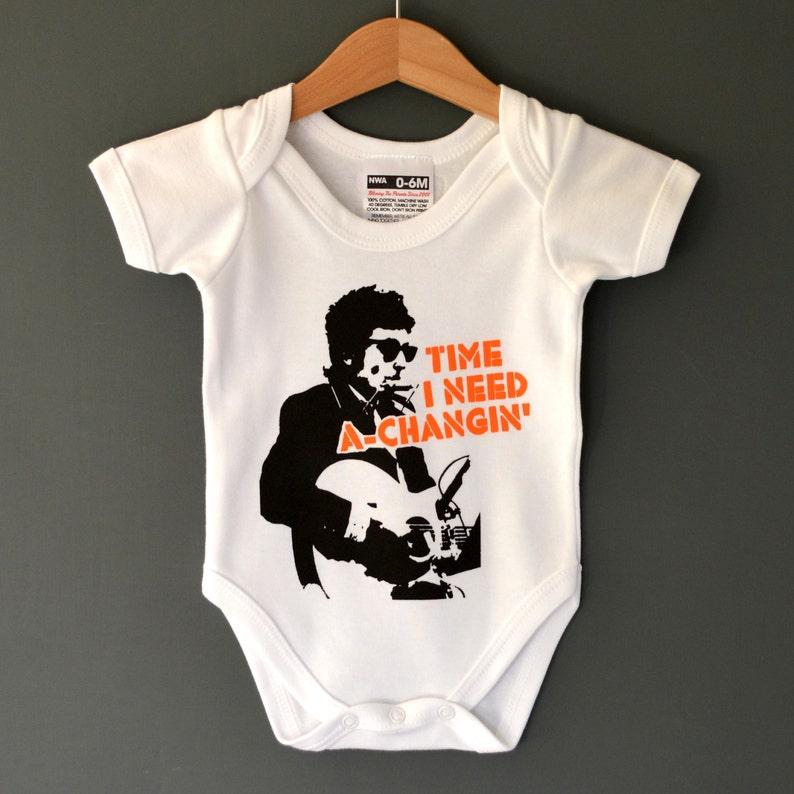 b2f1861bb Time I Need A Changin  Bob Dylan Baby Onesie.