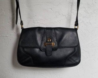 d7ab7ee56a Etienne Aigner Black leather shoulder bag with goldtone signature hardware.  Early 1990 s