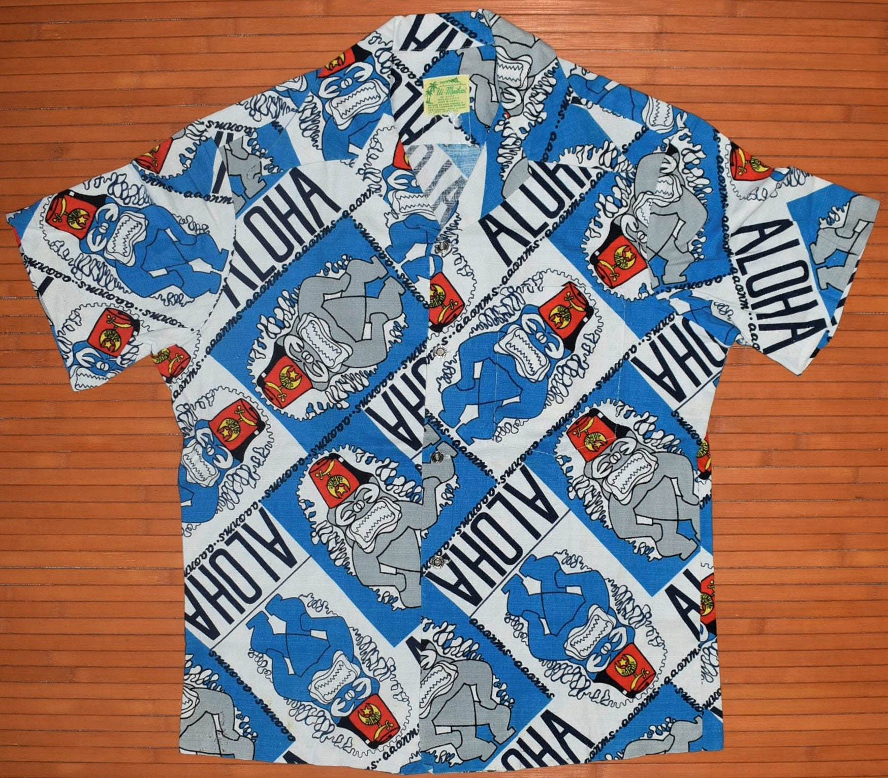 ce7560b1c25ac5 Men's 1960s Vintage Ui Maikai Blue Elvis Shriners Aloha Shirt - M ...