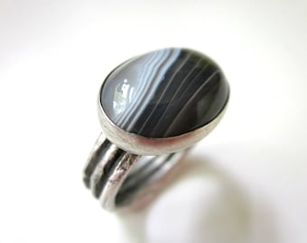 To Dash Against Darkness - primitive simple dark gray white banded Botswana agate stone cabochon, textured sterling silver oval ring
