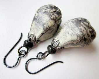 Beware of Words - primitive grungy weathered cream ceramic bell pods, bead caps, and soldered tinned black metal earrings