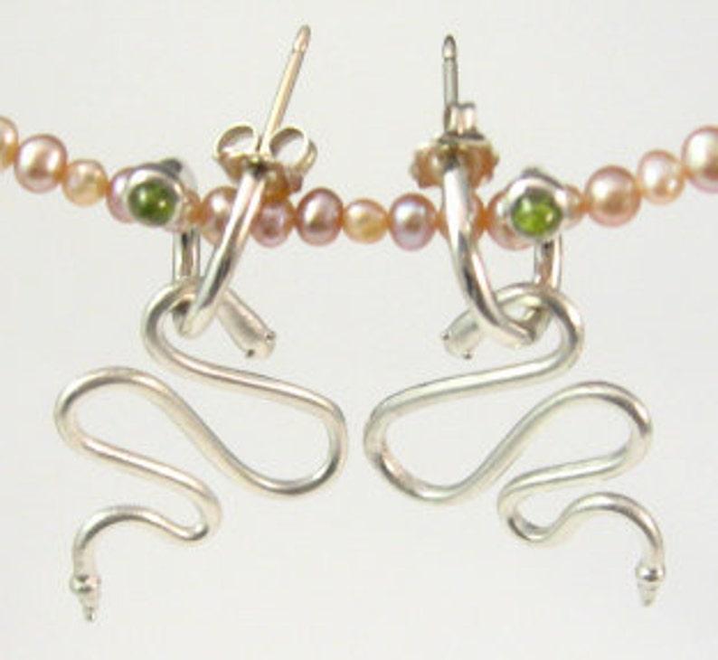 Snake Charm and Peridot Swirl Hoop Earrings in Platinum image 0