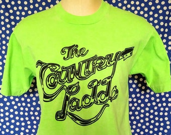a1a25ce9 Late 80's, early 90's The Country Ladds t-shirt, neon green/yellow, medium