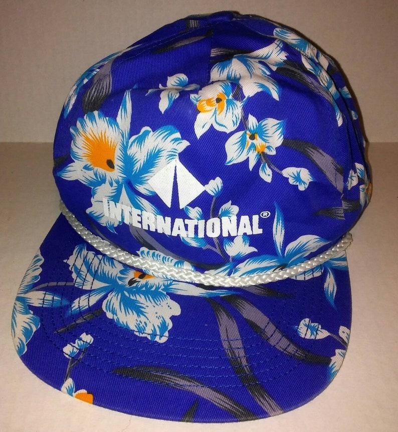 fa0afd63214 1980 s blue flowers snapback hat