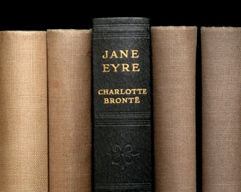 Jane Eyre book by Charlotte Bronte bound in vintage faux leather.