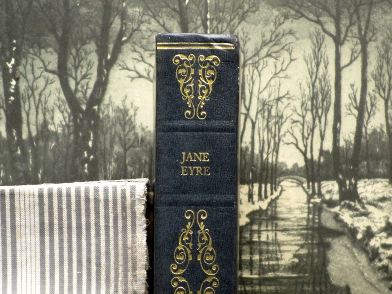 Jane Eyre book by Charlotte Bronte bound in dark blue faux image 0