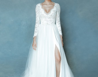 Wedding dress long sleeves lace and tulle skirt with a slit available. Feminine and comfortable