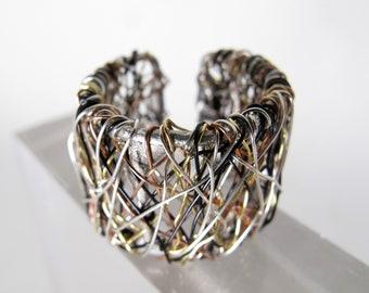 14k gold ring black, silver band, artist ring