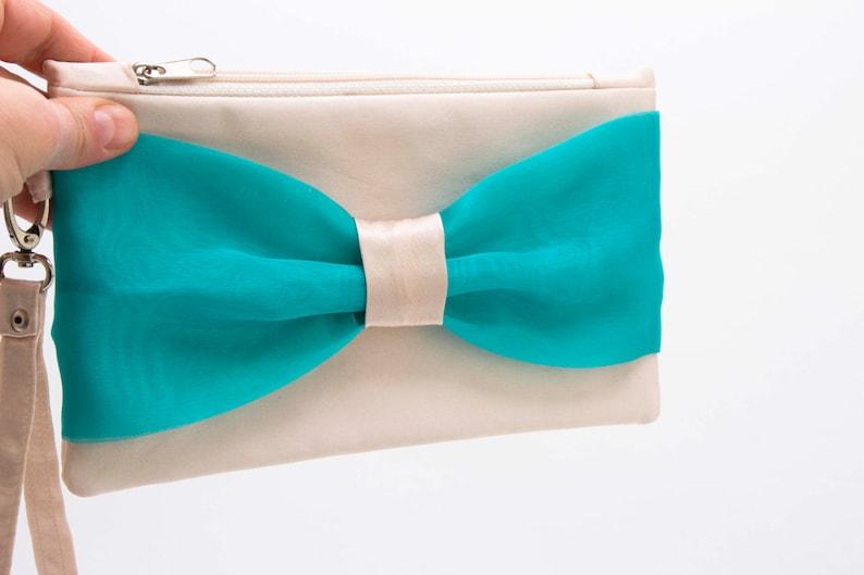 5772f97a88 Promotional sale Ivory cyan aqua turquoise bow wristlet | Etsy