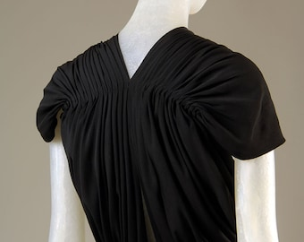 1939 Updated Claire McCardell evening blouse /Tournaround top or dress design sewing pattern. Unique gathered back and V front neck line.
