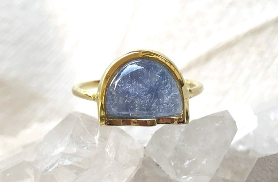 Wave ring in dumortierite and quartz and sold 18k gold