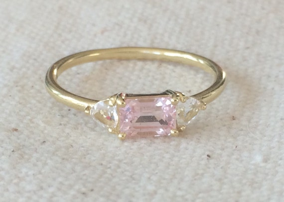 Untreated pink sapphire and phenakite engagement ring in solid 18k gold