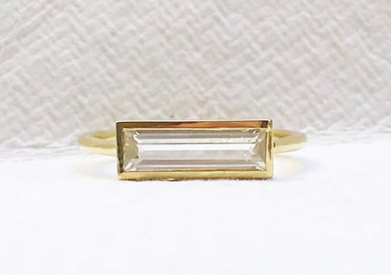 Nigerian phenakite horizon ring in solid 18k gold