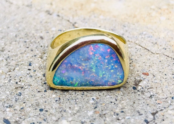 Solid Boulder opal and solid 18k gold and diamond ring
