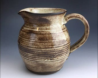 ceramic shino WATER/MILK PITCHER | potter finger ribbed texture, cream shino glaze, black clay show through, robust, old fashioned