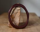 Australian Jarrah medium to large sized oval shaped fine wooden sculptural bangle