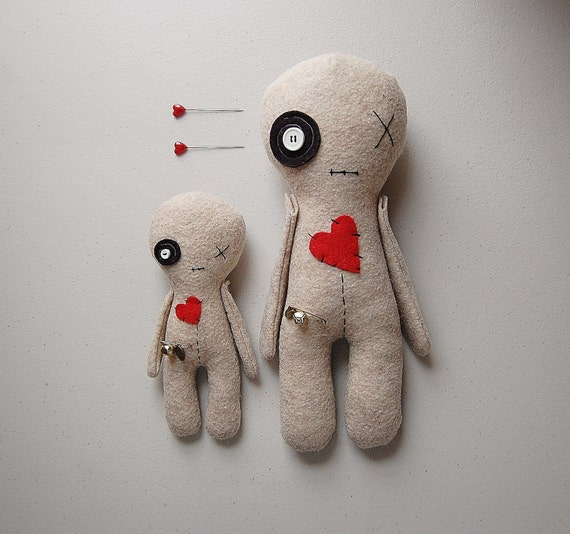 Two patched-up voodoo dolls.