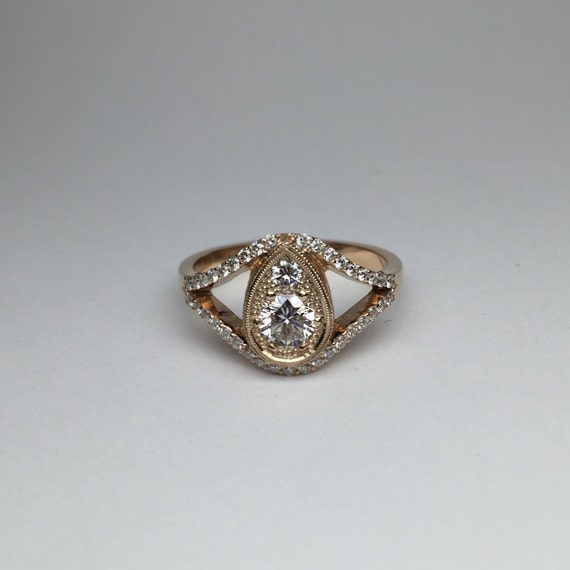 Pear Mirage Engagement Ring