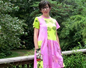 S. Block print Tshirt Dress in pink and yellow with roses, Dali clocks, and skull pockets. size small womens