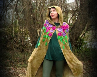 M. Nomad Vest with roses in sustainable bamboo fabric. Hood and pockets! Olive drab with pink and purple flowers, green leaves.