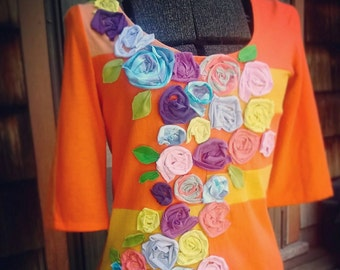 S. Upcycled Top with beautiful roses in many colors. Orange blouse with floral design.
