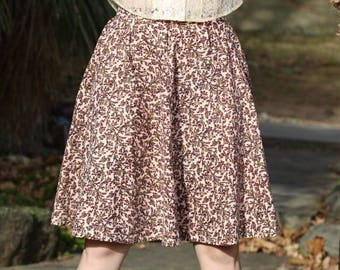 S. Brown and tan skirt, floral, twirly. Zipper back. Women's small,  2-4-6