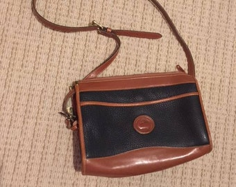 Vintage Dooney & and Bourke duck brand crossbody leather purse shoulder bag black brown trim