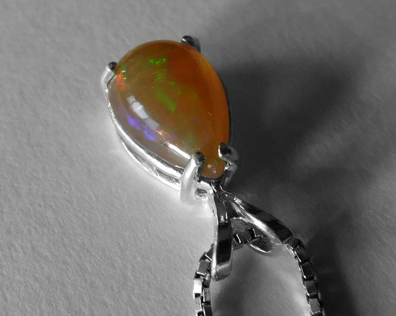 Ethiopian Opal Pendant in Silver 11.9 x 7.7 mm Cabochon Good Color Play Gold Body Color