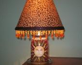 Sun face mason jar lamp...