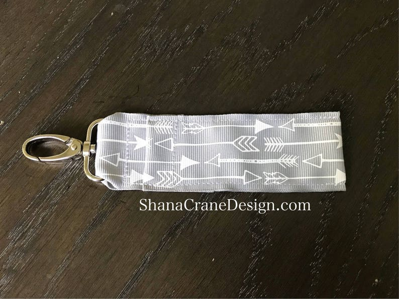 One Clip-On Lip Gloss Holder . Gray and White Arrows image 0