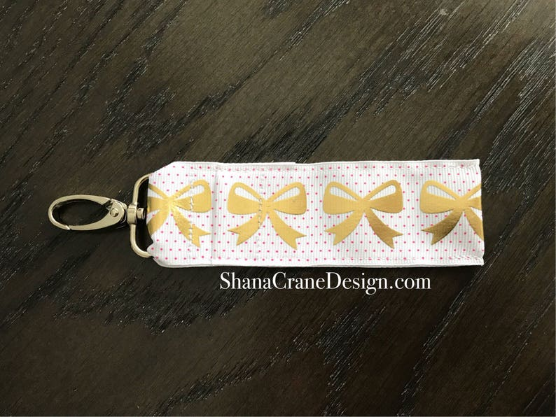 One Clip-On Lip Gloss Holder . Gold Bows image 0