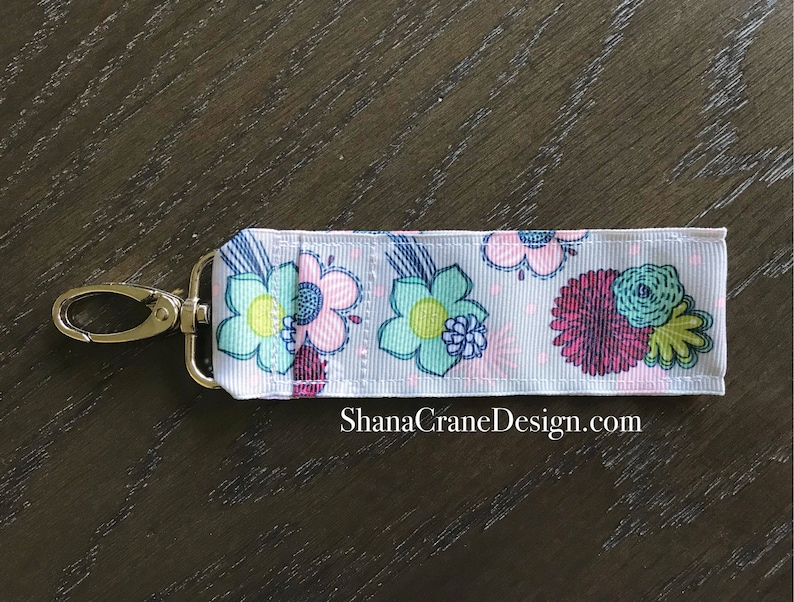 One Clip-On Lip Gloss Holder . Floral Sketch image 0