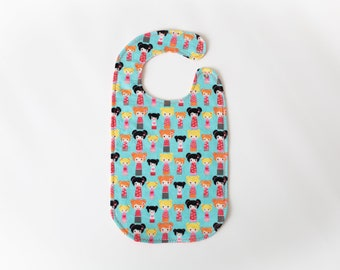 Flannel baby bib for girls. 10 inches long,  absorbent, washable, great for eating, reversible, snap-on