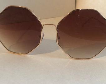 91db3bf97dfc41 Extra grote Octagon zonnebrillen