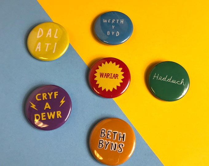 Featured listing image: Badge 38mm Pin Button Welsh Text Language Colourful Typography Retro Bright