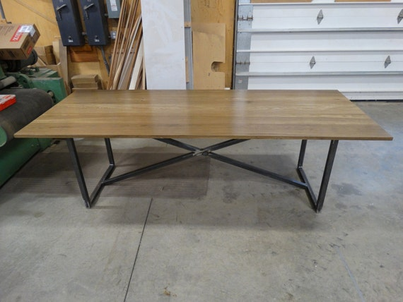 Modern rustic fumed oak dining table with a blackened steel base