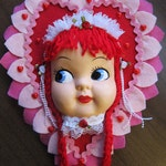 Vintage Celluloid Doll Face Heart Wall Decor Plaque