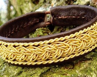 Nordic Sami gold cuff bracelet GRANI. Reindeer leather and antler closure