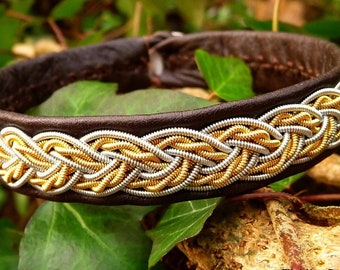 Lapland Sami bracelet. VIMUR viking style leather cuff, with two tone 14k gold and pewter braid