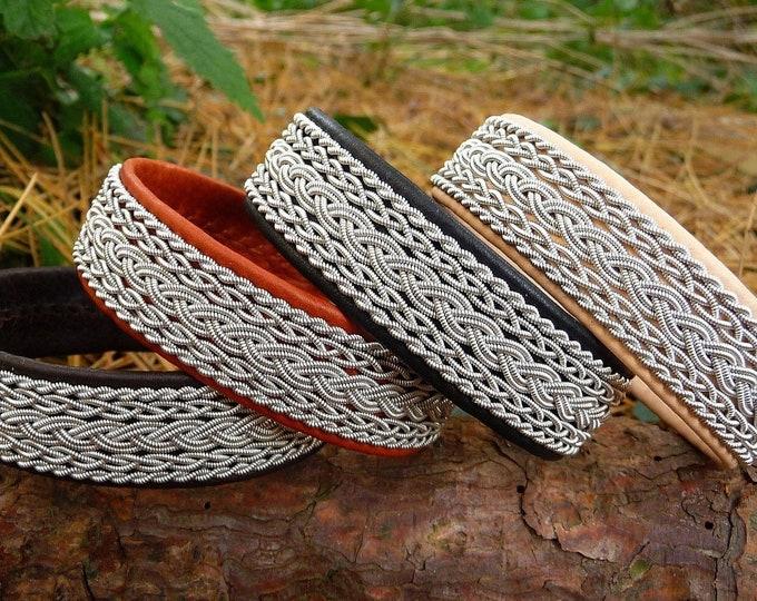 Featured listing image: SKADI Sami reindeer and pewter cuff bracelet. Handmade Scandinavian Folklore
