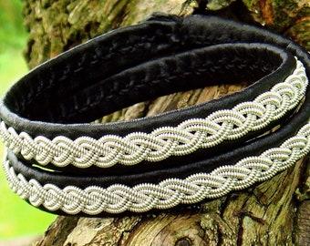 Nordic Sami Lapland wrap bracelet. LIDSKJALV reindeer leather, pewter braid, antler closure