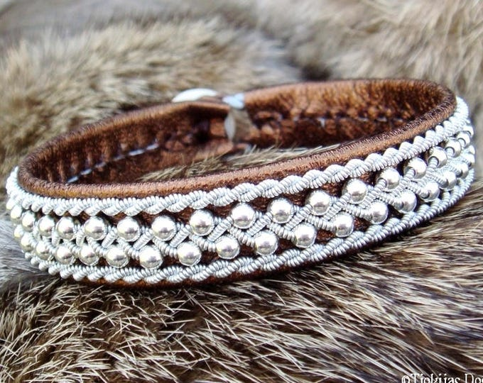 Swedish viking Sami bracelet, ROSKVA bronze lambskin cuff with sterling silver beads in pewter braid and antler closure