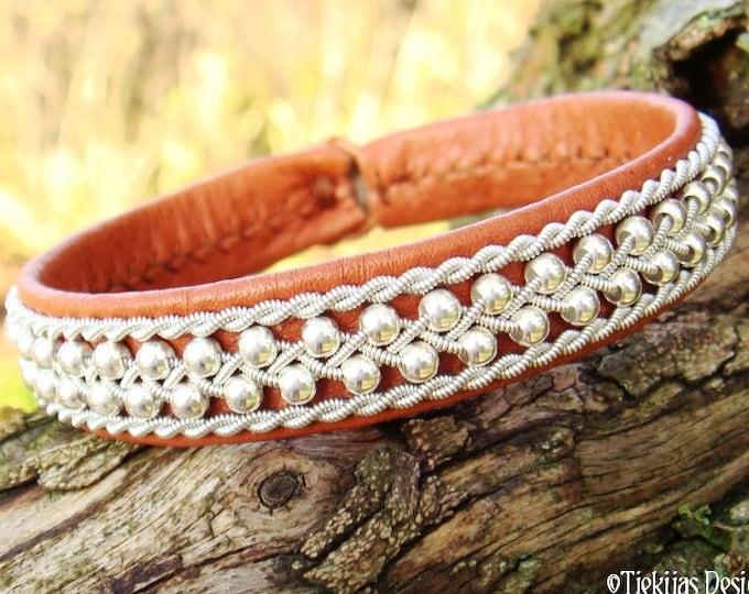Swedish Sami Bracelet, Viking Bracelet Cuff ROSKVA in bark tanned reindeer leather, sterling silver beads and pewter braid