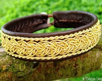 Gold Sami viking bracelet, GRANI unisex cuff in antique brown leather decorated with 14k gold braids, custom handmade nordic elegance