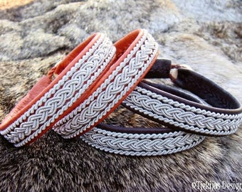 Vikings and shieldmaidens Nordic Sami bracelet, MJOLNIR bark tanned leather cuff with tin thread embroidery