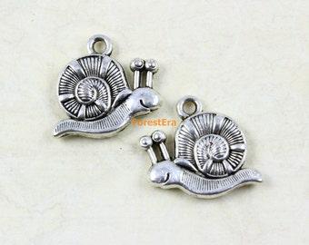 2 Snail charms antique silver tone A1070