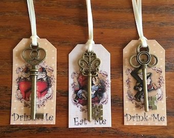 Alice in Wonderland 12 Eat Me, Drink Me party favors with bronze keys and silk ribbon