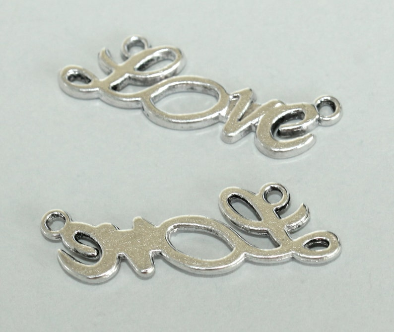 5588 100 Antiqued GOLD 28mm Sideways LOVE Connector Charm Link Bar Findings Lead Nickel Free USA 28x7mm Tibetan Style Word Love