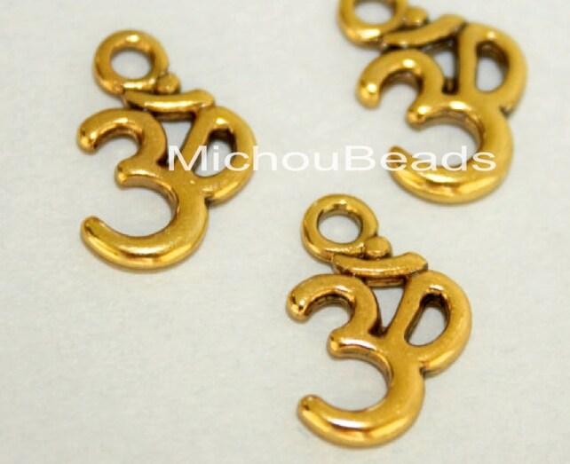 100 Antiqued Gold Om Symbol Yoga Charms 15x10mm Ohm Etsy