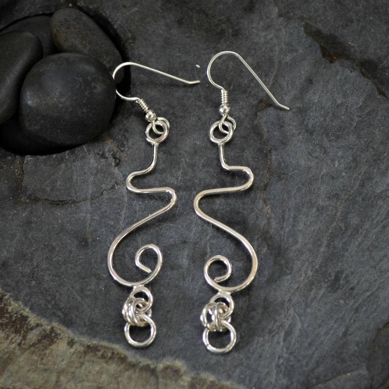 Long sterling silver dangle earrings.  Hand formed.  Tendrils image 0